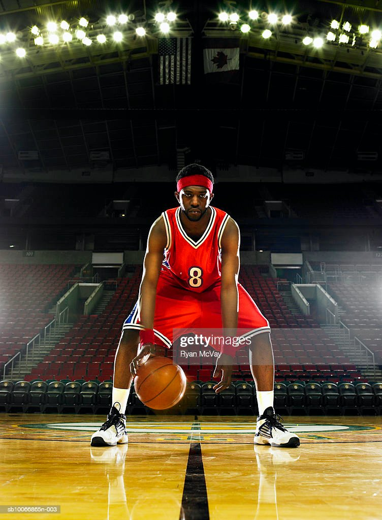 Basketball player dribbling basketball, portrait