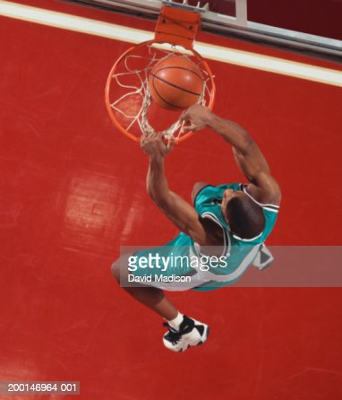 Basketball player dunking ball, overhead view