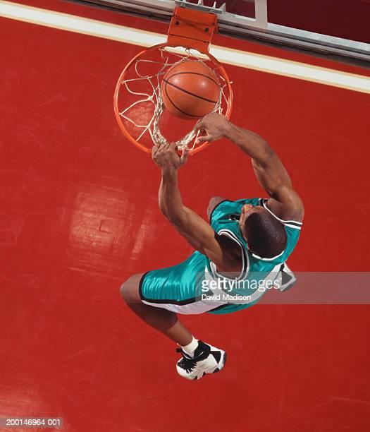 Basketball player dunking ball, overhead view