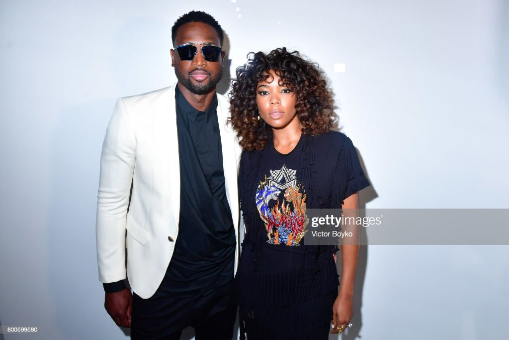 Basketball Player Dwyane Wade and actress Gabrielle Union attend the Balmain Menswear Spring/Summer 2018 show as part of Paris Fashion Week on June 24, 2017 in Paris, France.
