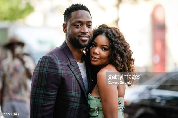 Basketball player Dwayne Wade and Gabrielle Union are seen outside the Valentino show during Paris Fashion Week Menswear Spring/Summer 2018 on June...