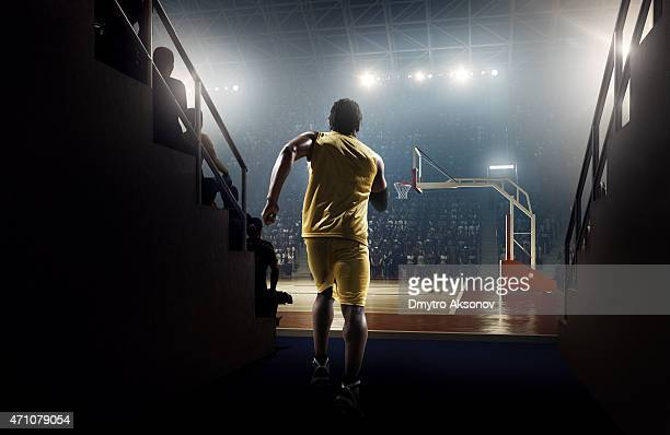 Basketball player enters the arena