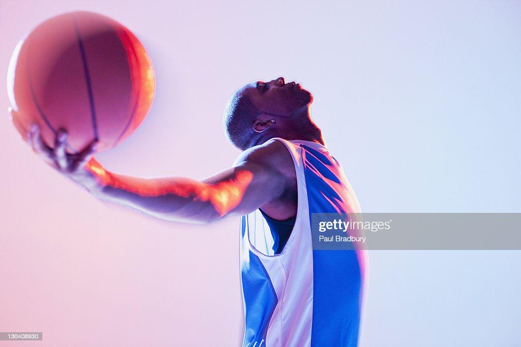 Basketball player holding ball : Stock Photo