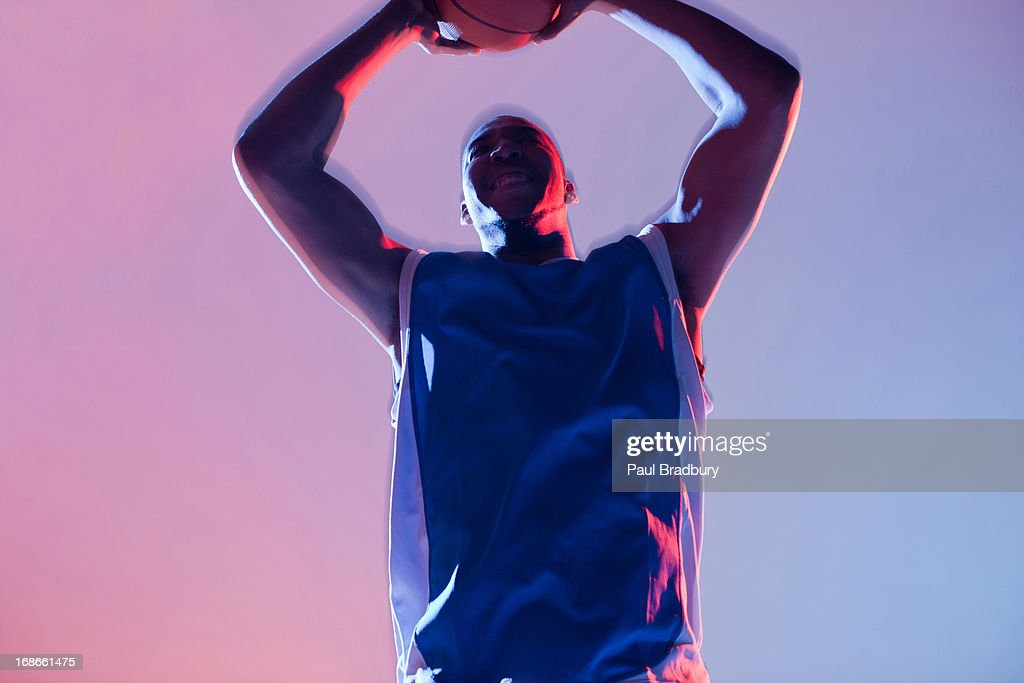 Basketball player holding ball : Stock Photo