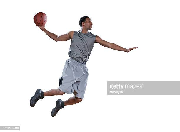 Joueur de basket-ball mi-air de faire un jump shot