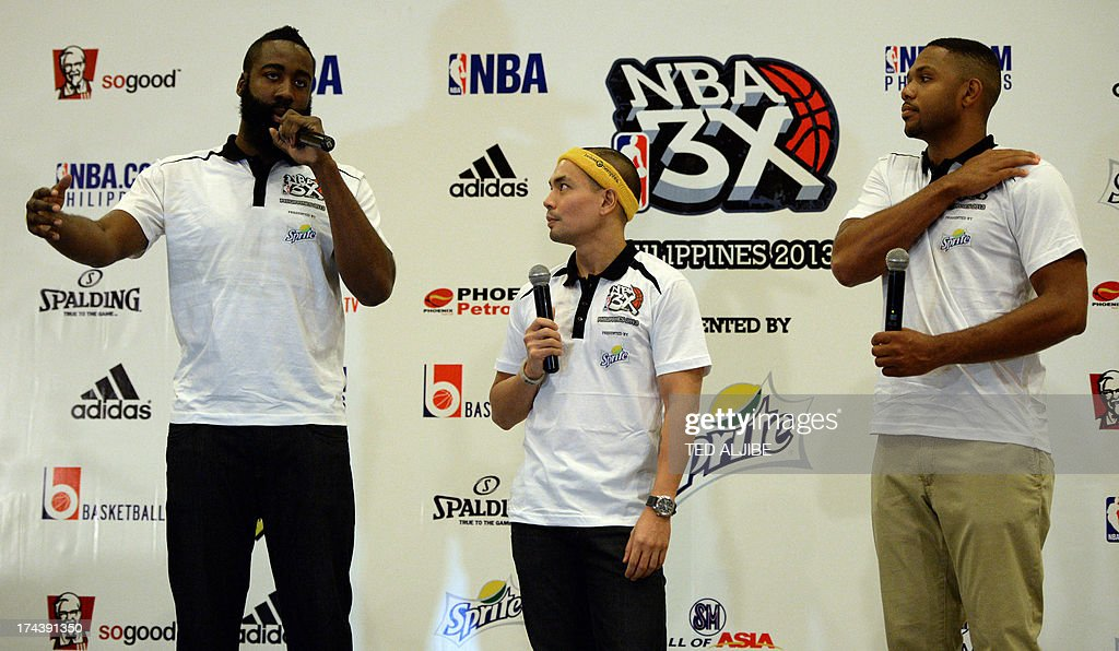 NBA basketball player James Harden (L) of the Houston Rockets, answers a question while Eric Gordon (R) of New Orleans Pelicans and an unidetified man (C) listen during a press conference in Manila on July 25, 2013. Harden and Gordon are in Manila to promote the NBA pre-season games dubbed 'NBA 3X Asia' slated for October 2013.