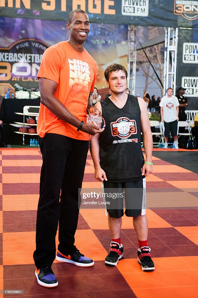 Basketball Player Jason Collins (L) and actor Josh Hutcherson attend the 5th annual Nike basketball 3ON3 tournament presented by NBC4 southern california held at L.A. LIVE on August 9, 2013 in Los Angeles, California.
