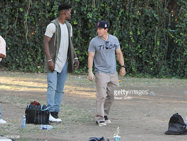 Basketball player Jimmy Butler and Mark Wahlberg are seen on November 21 2015 in Los Angeles California