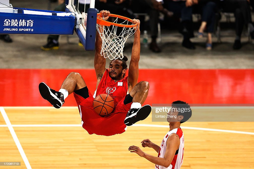 Basketball Player <a gi-track='captionPersonalityLinkClicked' href=/galleries/search?phrase=Joakim+Noah&family=editorial&specificpeople=699038 ng-click='$event.stopPropagation()'>Joakim Noah</a> in action with Han Shuo during the 2013 Yao Foundation Charity Game between China and the NBA Stars on July 1, 2013 in Beijing, China.