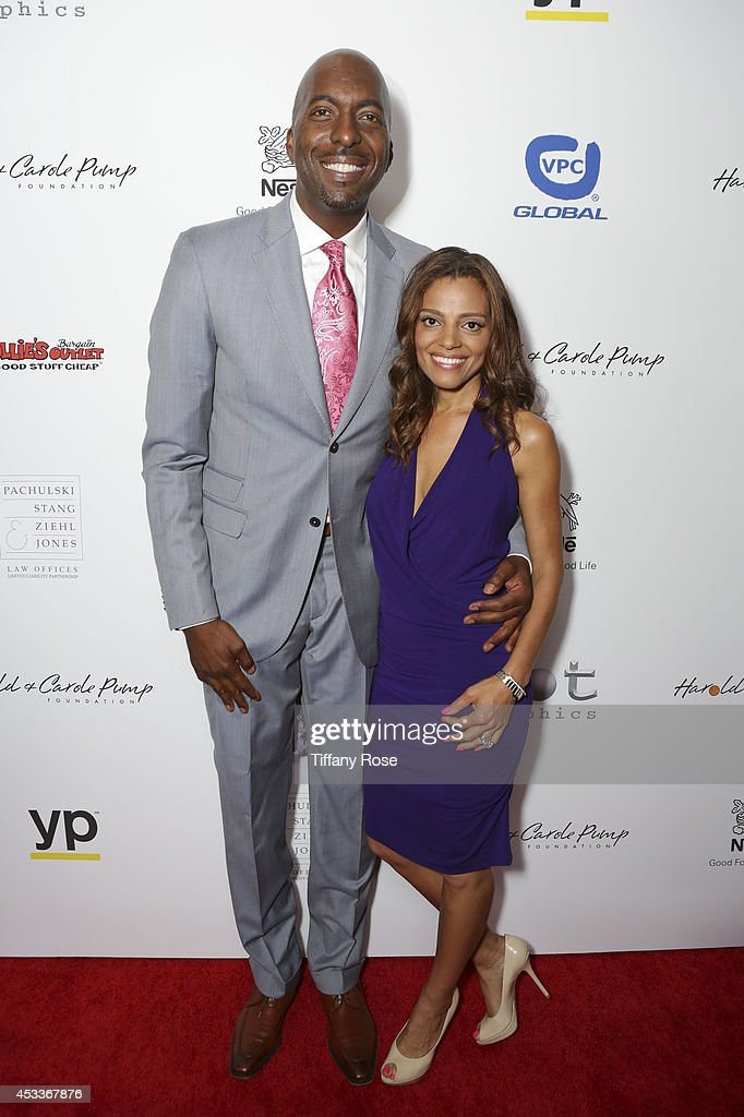 Basketball player John Salley and Natasha Scott attend the 14th Annual Harold & Carole Pump Foundation Event on August 8, 2014 in Los Angeles, California.