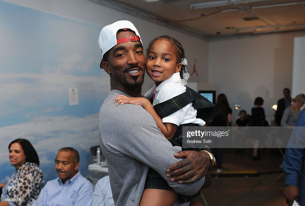Basketball player JR Smith and daughter Demi Smith pose for a photo backstage at the Nike/Levi Kids fashoin show during MercedesBenz Fashion Week...