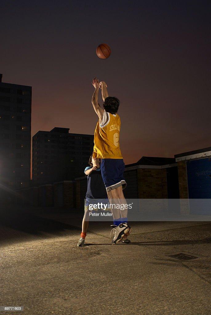basketball player jumping and shooting : Stock Photo