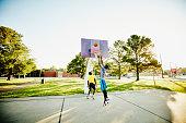 Basketball player jumping to rebound ball