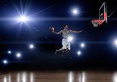 Basketball player jumping toward the net