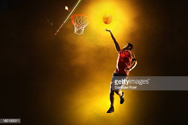 Basketball player jumping with glowing ball
