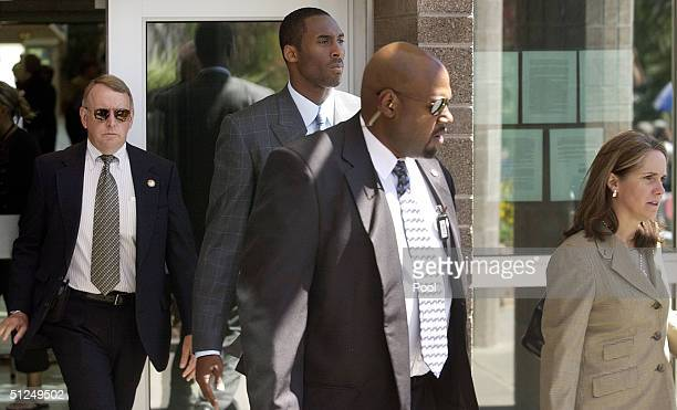 Basketball player Kobe Bryant leaves for the lunch break with his attorney Pamela Mackey and security at Eagle County Justice Center during the third...
