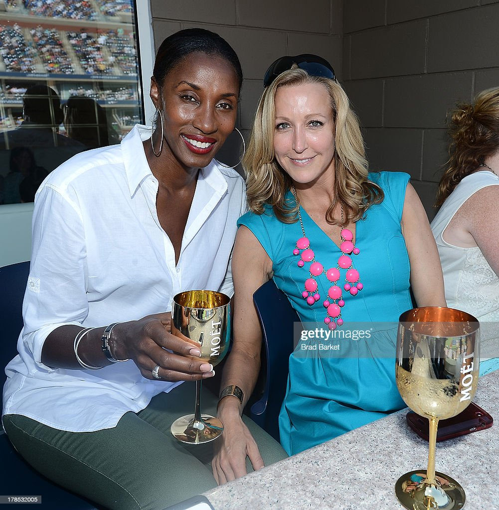 Basketball player Lisa Leslie-Lockwood (L) and <a gi-track='captionPersonalityLinkClicked' href=/galleries/search?phrase=Lara+Spencer&family=editorial&specificpeople=240321 ng-click='$event.stopPropagation()'>Lara Spencer</a> attend The Moet & Chandon Suite at USTA Billie Jean King National Tennis Center on August 29, 2013 in New York City.