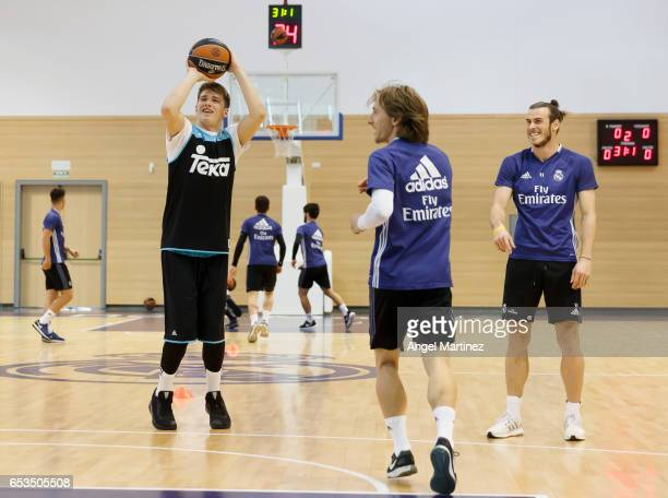 Basketball player Luka Doncic Luka Modric and Gareth Bale of Real Madrid in action during a training session at Ciudad Real Madrid basketball court...