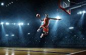 Basketball player makes slam dunk