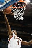 Basketball player making a basket