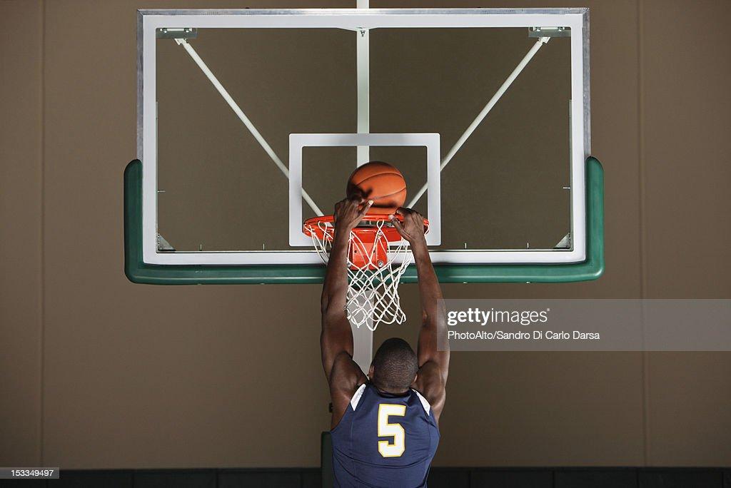 Basketball player making a basket : Stock Photo