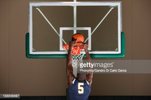 Basketball player making a basket : Stock Photo