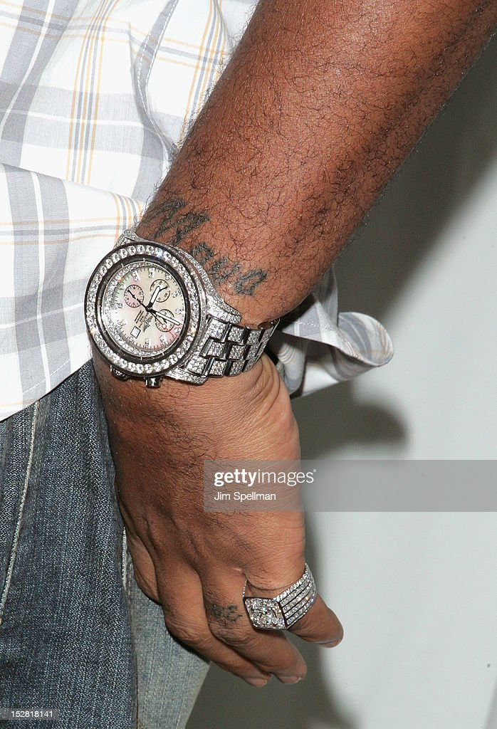NBA basketball player <a gi-track='captionPersonalityLinkClicked' href=/galleries/search?phrase=Marcus+Camby&family=editorial&specificpeople=201722 ng-click='$event.stopPropagation()'>Marcus Camby</a> (jewelry detail) attends 'A Year In A New York Minute' Photo Exhibition at Canoe Studios on September 26, 2012 in New York City.