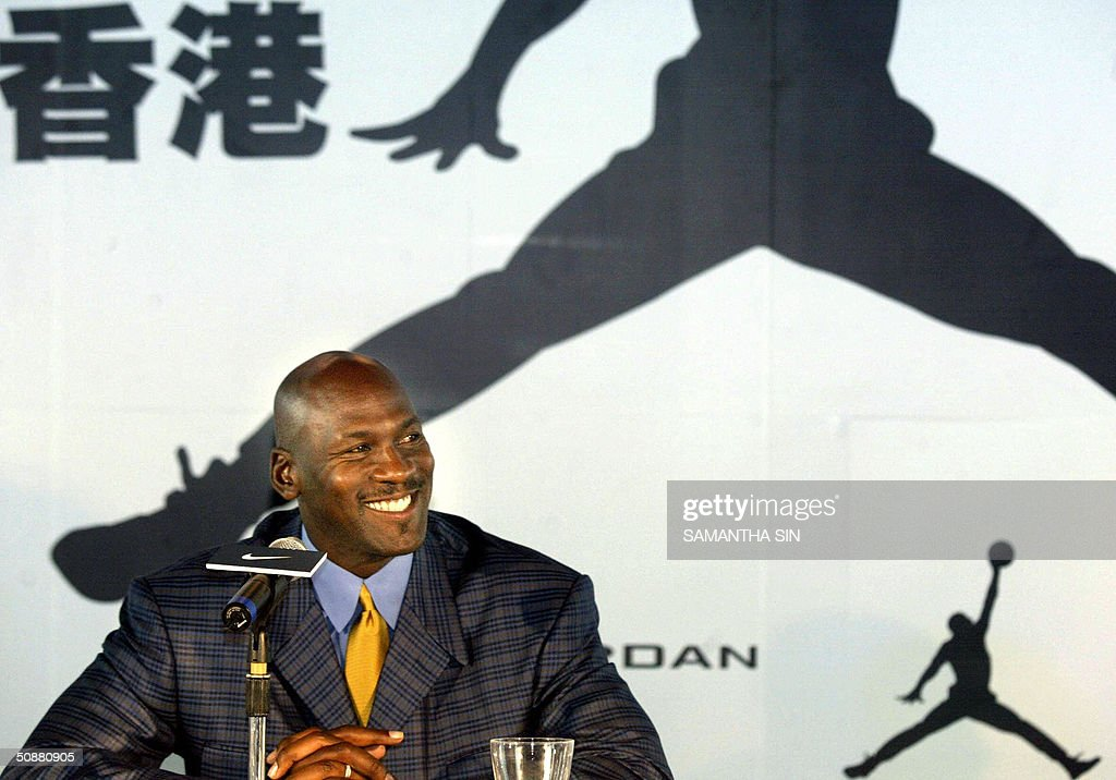 Basketball player <a gi-track='captionPersonalityLinkClicked' href=/galleries/search?phrase=Michael+Jordan+-+Basketball+Player&family=editorial&specificpeople=73625 ng-click='$event.stopPropagation()'>Michael Jordan</a> smiles during a news conference in Hong Kong 21 May 2004. Jordan is visiting Hong Kong for the first time. AFP PHOTO/Samantha SIN