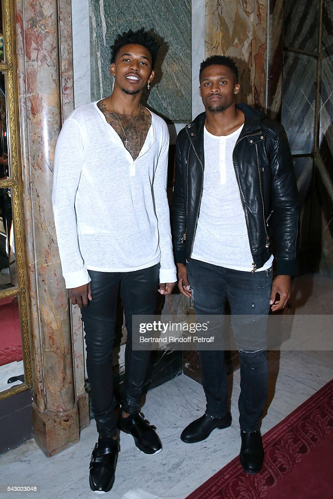 Basket-Ball player Nick Young and American Football player Brice Butler attend the Balmain Menswear Spring/Summer 2017 show as part of Paris Fashion Week on June 25, 2016 in Paris, France.