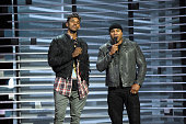 Basketball player Nick Young and LL Cool J speak onstage at AE Networks 'Shining A Light' concert at The Shrine Auditorium on November 18 2015 in Los...
