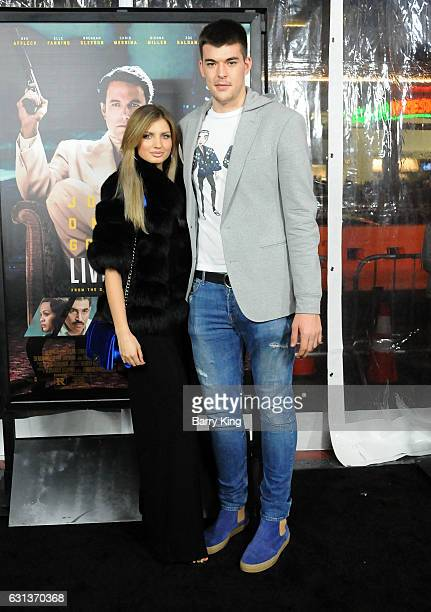 NBA basketball player of Los Angeles Lakers Ivica Zubac and guest attend the premiere of Warner Bros Pictures' 'Live By Night' at TCL Chinese Theatre...