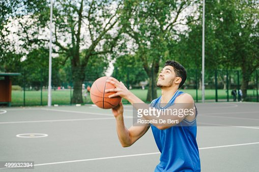 Basketball Player On The Court, Preparing To Dunk Ball