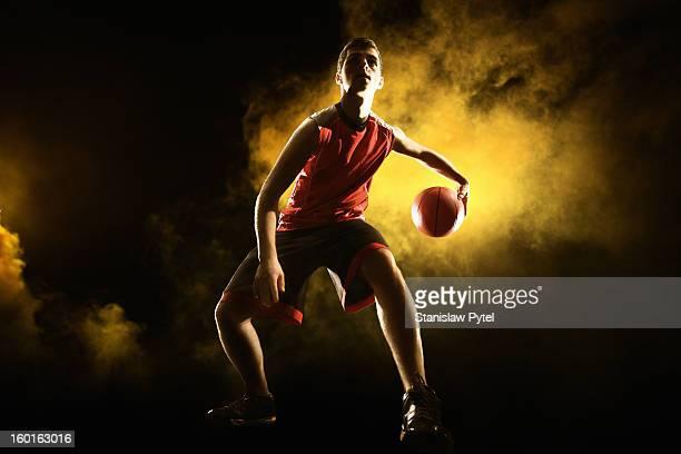 Basketball player on yellow smoky background