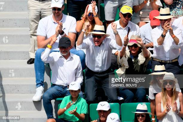 Basketball player Pau Gasol and his girlfriend and French businessman Richard Mille attend the final tennis match between Spain's Rafael Nadal and...