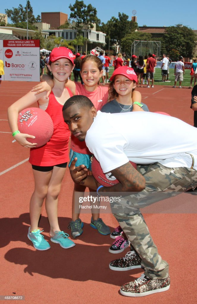 Basketball player <a gi-track='captionPersonalityLinkClicked' href=/galleries/search?phrase=Quincy+Miller+-+Basketball+Player&family=editorial&specificpeople=9866654 ng-click='$event.stopPropagation()'>Quincy Miller</a> poses with kids at Kickball For A Home - Celebrity Challenge Presented By Dave Thomas Foundation For Adoption at the University of Southern California on August 16, 2014 in Los Angeles, California.