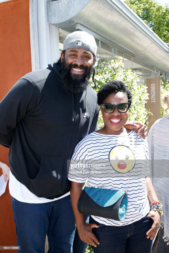 Basket-Ball player Ronny Turiaf and humorist Claudia Tagbo attend the Women Final of the 2017 French Tennis Open - Day Fourteen at Roland Garros on June 10, 2017 in Paris, France.