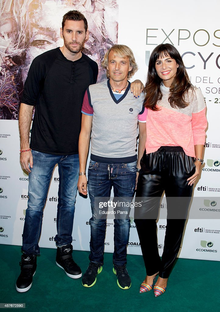 Basketball player Rudy Fernandez, Jesus Calleja and <a gi-track='captionPersonalityLinkClicked' href=/galleries/search?phrase=Nuria+Roca&family=editorial&specificpeople=491015 ng-click='$event.stopPropagation()'>Nuria Roca</a> attend 'Upcycling' Photogrpahy competition party photocall at EFTI School on October 22, 2014 in Madrid, Spain.
