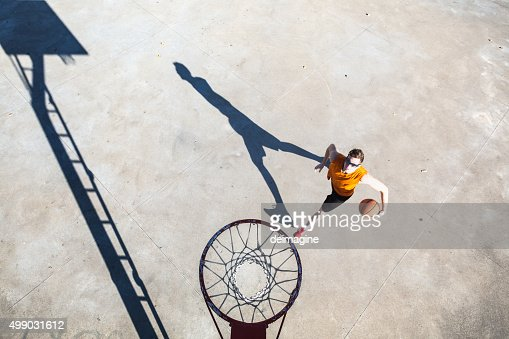 Basketball player runs to the basket hoop