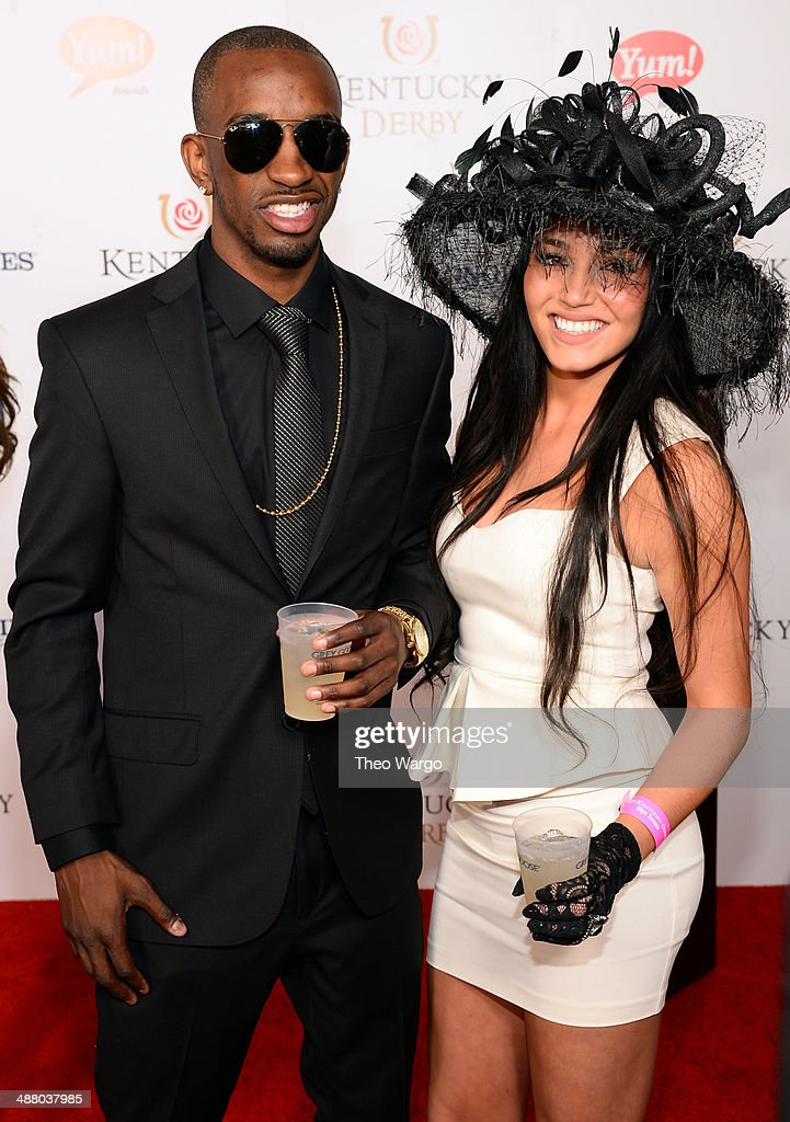 Basketball player <a gi-track='captionPersonalityLinkClicked' href=/galleries/search?phrase=Russ+Smith+-+Basketballer&family=editorial&specificpeople=10584261 ng-click='$event.stopPropagation()'>Russ Smith</a> (left) at GREY GOOSE Lounge at 140th Kentucky Derby at Churchill Downs on May 3, 2014 in Louisville, Kentucky.