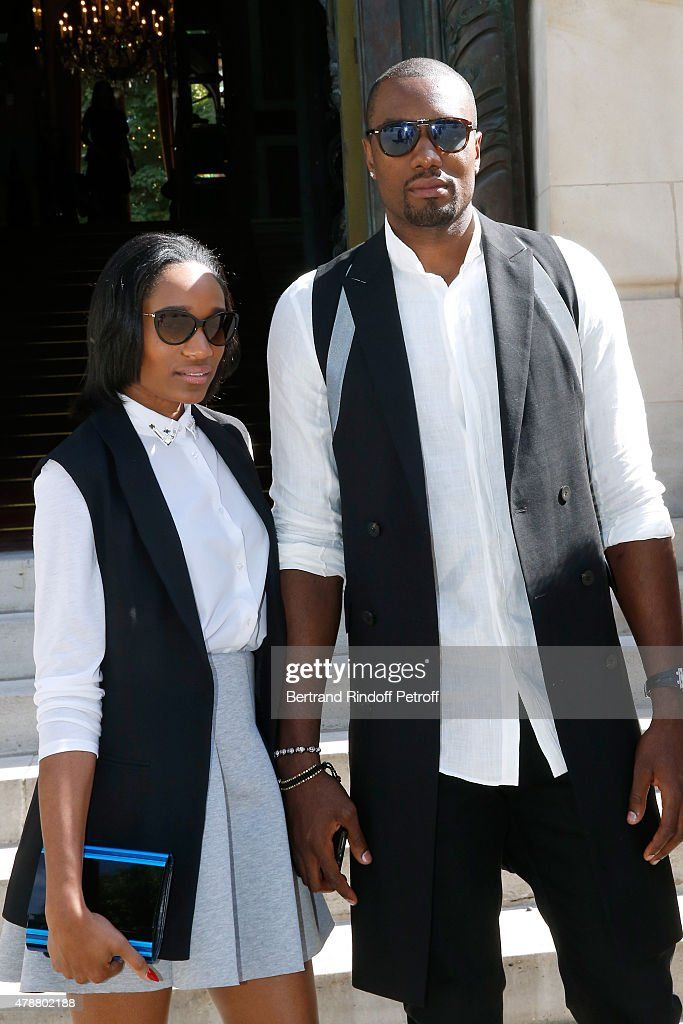 Basketball Player <a gi-track='captionPersonalityLinkClicked' href=/galleries/search?phrase=Serge+Ibaka&family=editorial&specificpeople=5133378 ng-click='$event.stopPropagation()'>Serge Ibaka</a> and his wife attend the Balmain Menswear Spring/Summer 2016 show as part of Paris Fashion Week on June 27, 2015 in Paris, France.