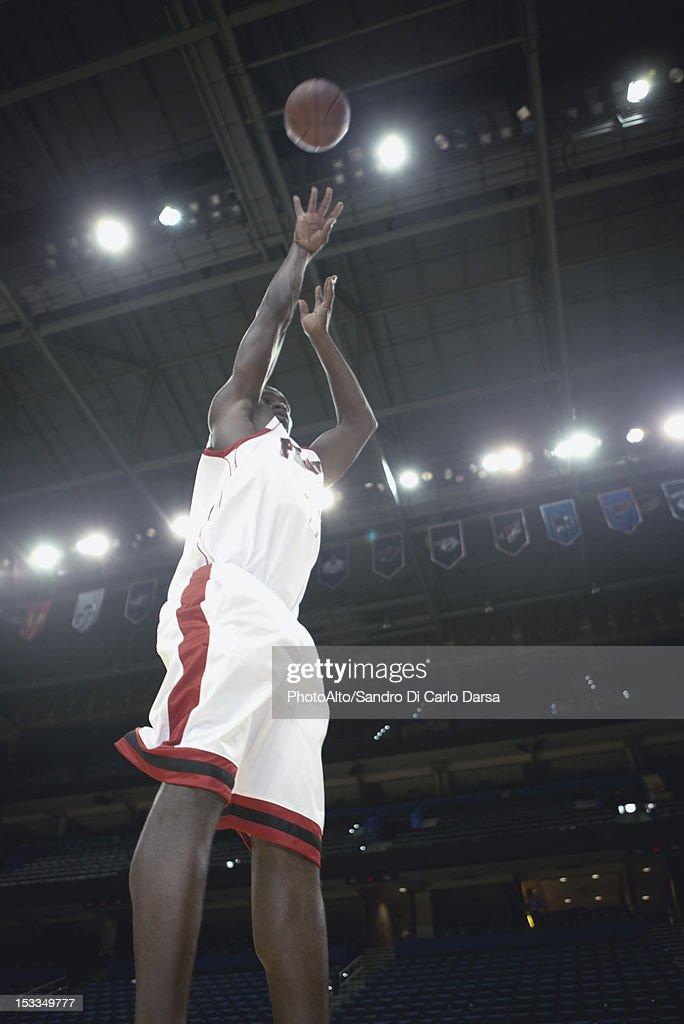 Basketball player shooting basketball : Stock Photo