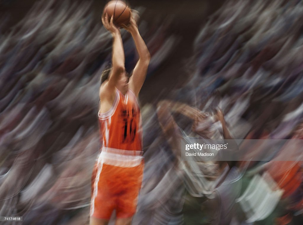 Basketball player shooting goal (blurred motion) : Stock Photo