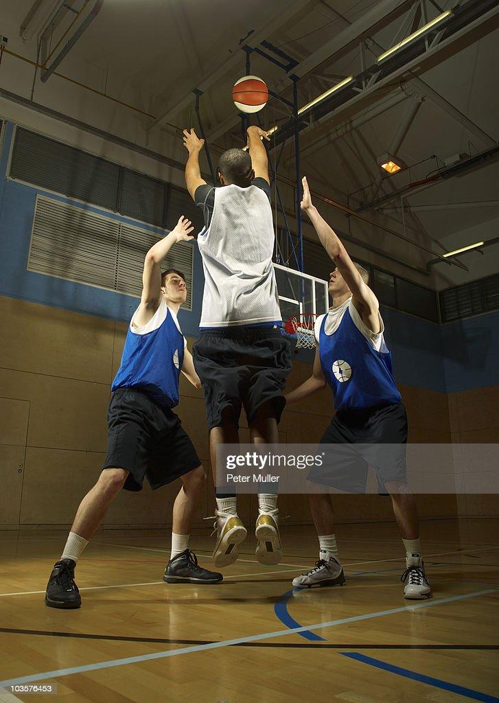 Basketball player shooting : Stock Photo
