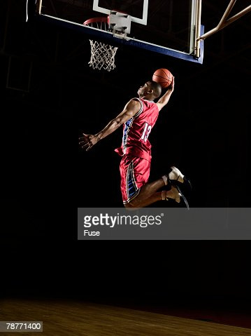 Basketball Player Slam Dunking
