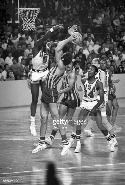 US basketball player Spencer Haywood is about to block a shot by Brazil's Antonio Succas during Olympic action 10/22 The US beat Brazil 7563 to...