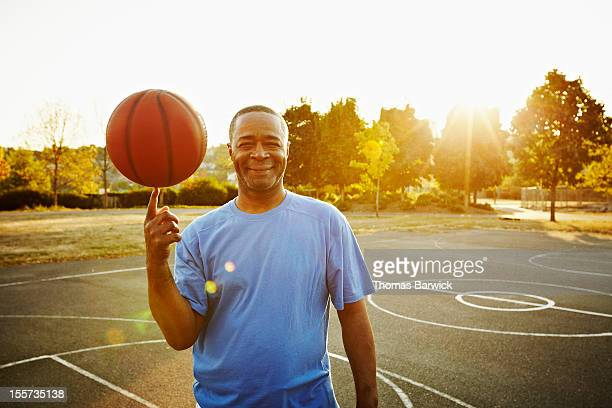 Basketball player spinning ball on fingertip