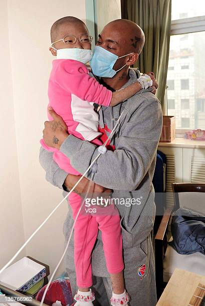 Basketball player Stephon Marbury of Beijing Jinyu visits Fan Yuanchen who has Leukaemia at Dao Pei Hospital on December 13 2011 in Beijing China...