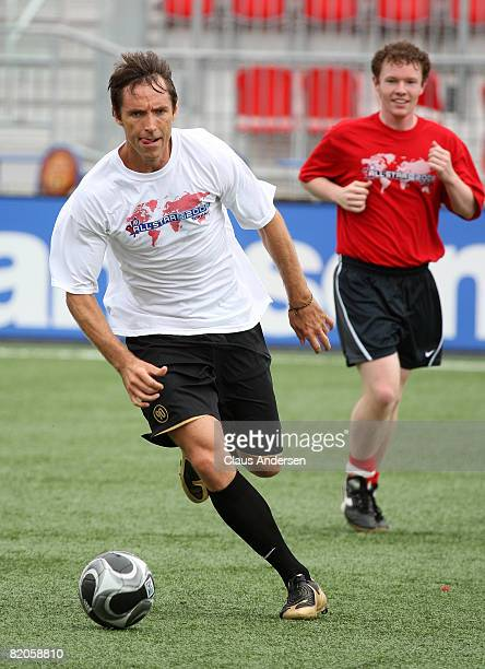 NBA basketball player Steve Nash plays soccer with members of the media during the MLS All Star Media Game at BMO Field on July 24 2008 in Toronto...