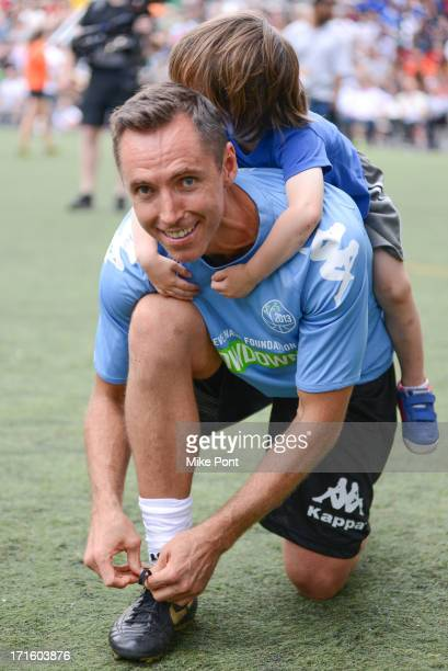 Basketball Player Steve Nash with son Matteo Joel Nash attend The Sixth Edition Steve Nash Foundation Showdown at Sarah D Roosevelt Park on June 26...