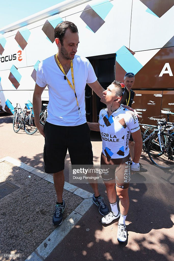 Basketball player Tomas Van Den Spiegel of Belgium interviews <a gi-track='captionPersonalityLinkClicked' href=/galleries/search?phrase=Samuel+Dumoulin&family=editorial&specificpeople=760365 ng-click='$event.stopPropagation()'>Samuel Dumoulin</a> (R) of France and Team AG2R La Mondiale is seen prior to the start of stage two of the 2013 Tour de France, a 156KM road stage from Bastia to Ajaccio, on June 30, 2013 in Bastia, France.